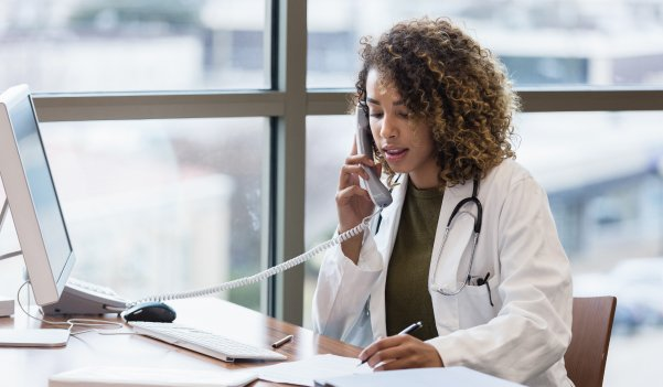 Doctor on the phone to a patient